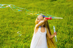 Girl blow bubbles. Royalty Free Stock Image