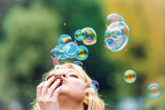 Girl blow bubbles Royalty Free Stock Images