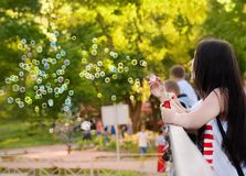 Girl blow bubbles in the flashmob dedicated to Children's Day Stock Photo