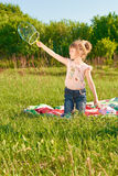 Girl blow bubbles Stock Image