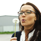 Girl blow on dandelion Stock Images