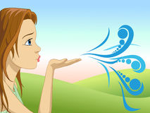 Girl blow with the palm of your hand Royalty Free Stock Photo