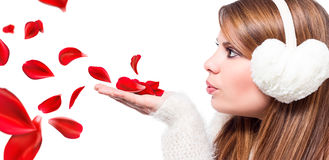Girl blow petals. Blond girl blow red petals Stock Images