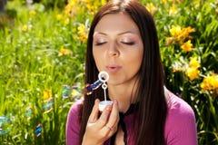 Girl blow soap bubble Stock Photos