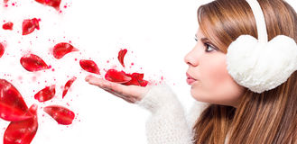 Girl blow sparking petals Stock Photo