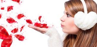 Girl blow sparking petals Stock Photo