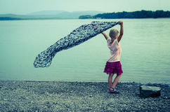 Girl with blowign scarf Royalty Free Stock Image