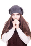 Girl blowinf in her arm from cold isolated on white background Royalty Free Stock Images