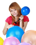 Girl blowing air balloon Stock Photos