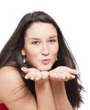 Girl blowing away a kiss Stock Photos