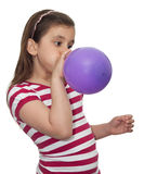 Girl blowing a balloon stock images