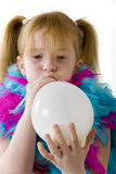 Girl is blowing balloon Royalty Free Stock Images