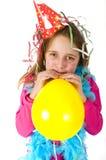 Girl blowing balloon Stock Photo