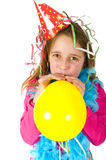 Girl blowing balloon Royalty Free Stock Photos