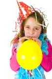 Girl blowing balloon Royalty Free Stock Photos