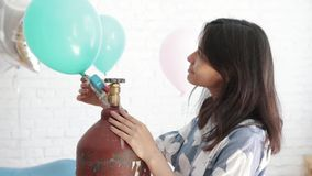 Girl blowing a balloon. Girl blowing a balloon on holiday stock video