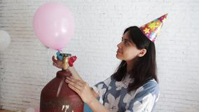 Girl blowing a balloon. Girl blowing a balloon on holiday stock footage