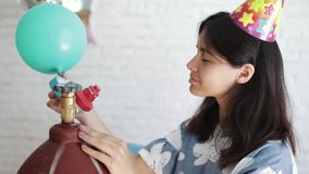 Girl blowing a balloon. Girl blowing a balloon on holiday stock video footage