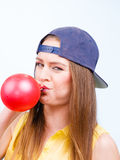 Girl blowing a baloon. Hobby entertainment celebration concept royalty free stock images