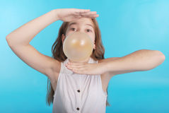 Girl blowing a big bubble gum bubble Stock Photography