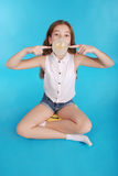 Girl blowing a big bubble gum bubble Royalty Free Stock Photography