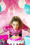 Girl Blowing Birthday Candles Out Royalty Free Stock Photography