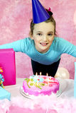 Girl Blowing Birthday Candles Out Royalty Free Stock Image
