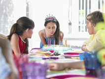 Girl Blowing Birthday Candles At Party Royalty Free Stock Photography