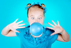 Girl Blowing Blue Bubble Gum Royalty Free Stock Images