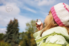 Girl blowing a bubble Royalty Free Stock Image
