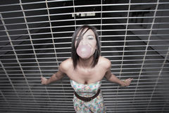 Girl blowing a bubble Royalty Free Stock Images