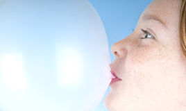 Girl blowing bubble Stock Images