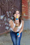 Girl blowing bubble Royalty Free Stock Photos
