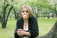 Girl blowing bubble with bubble gum Royalty Free Stock Photography