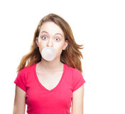 Girl blowing bubble from chewing gum Royalty Free Stock Images