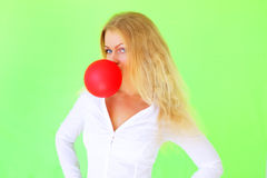 Girl blowing bubble gum Stock Image