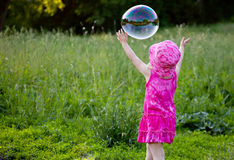 A girl is blowing bubbles Stock Images