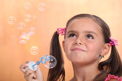 Girl blowing bubbles Royalty Free Stock Images