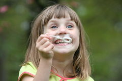 Girl blowing bubbles 4. Girl blowing bubbles waith wand, 4th in series royalty free stock images