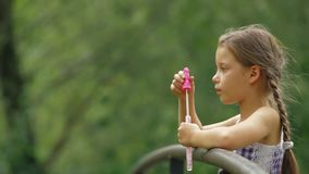 Girl Blowing Bubbles stock footage