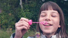 Girl blowing bubbles in the Park on a summer evening. stock video footage