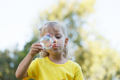 Girl Blowing Bubbles Into the Sun Royalty Free Stock Photo
