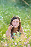Girl blowing bubbles Royalty Free Stock Photos