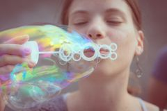 Girl blowing bubbles. Stock Image