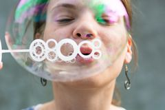 Girl blowing bubbles. Royalty Free Stock Photography