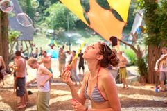 Girl blowing bubles on Ozora Festiva Stock Images