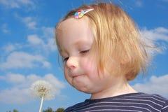 Girl blowing dandelion Royalty Free Stock Photo