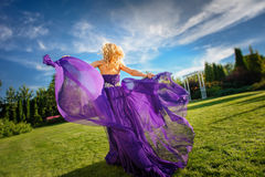 Girl in blowing dress Outdoors stock photography