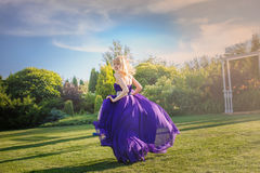 Girl in blowing dress Outdoors Stock Photo