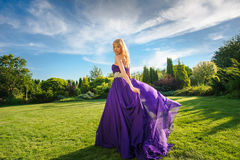 Girl in blowing dress Outdoors Royalty Free Stock Image